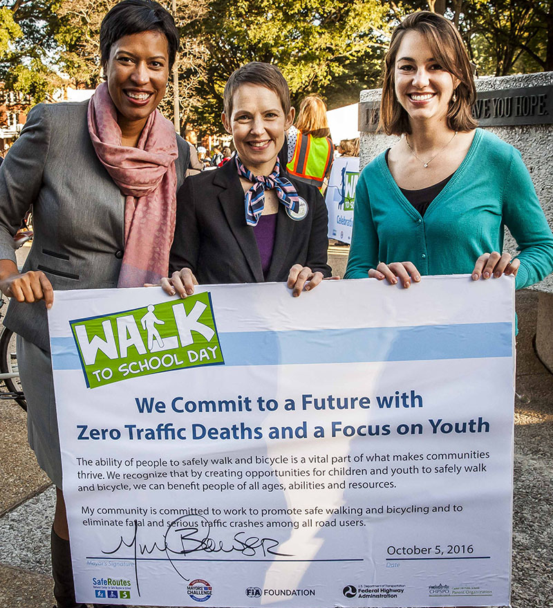 DC Mayor Muriel Bowser signs commitment to an urban future with zero traffic deaths.
