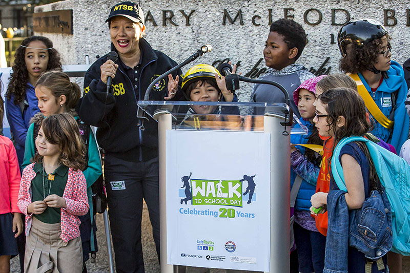 National Transportation Safety Board Vice Chairman Bella Dinh-Zarr joins children to promote safe walking and cycling behavior.