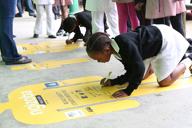 Students took the Ngizoba pledge, meaning 'I will' be a safe road user.