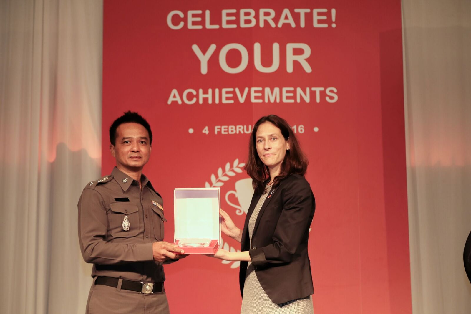 Save the Children's Thailand Country Director, Kim Koch (right) presented awards to police, schools, government authorities and other partners who have supported the initiative.