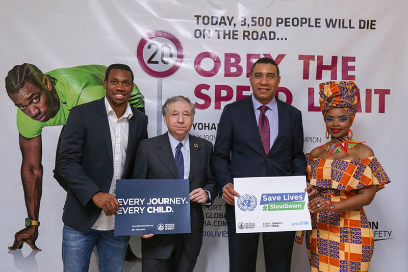 Athlete Yohan Blake (in front of his #3500LIVES poster), Jean Todt and Zoleka Mandela joined Prime Minister Holness to mark UN Global Road Safety Week.