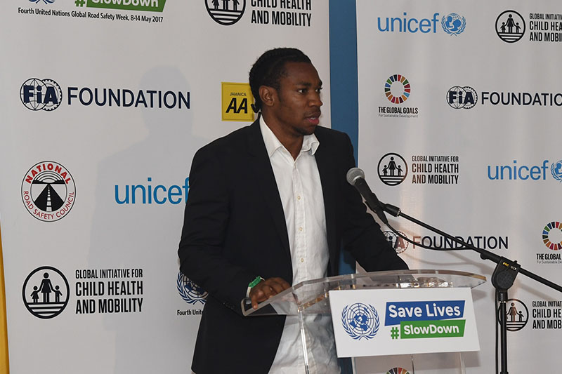 "Fastest men in the world say #slowdown. Above: Athlete Yohan Blake spoke at the event: 'Leave the speed to me"". Below: Athlete Usain Bolt also supported the campaign."