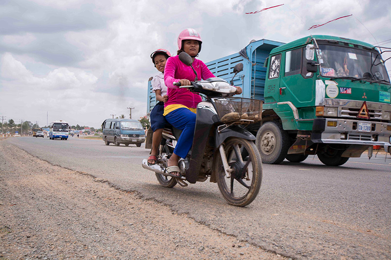 Chantheavin rides with her mother. An AIP Foundation helmet prevented serious injury when she was involved in a motorcycle crash.