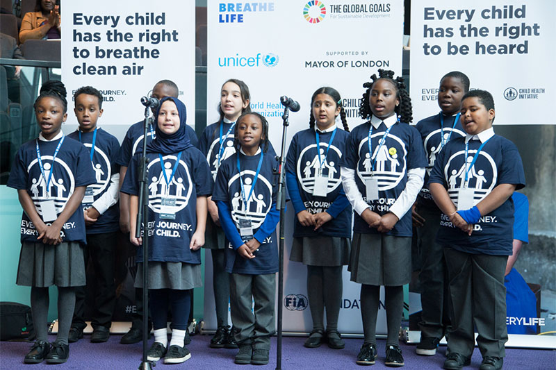 Children from a local school performed a rap song calling for clean air.