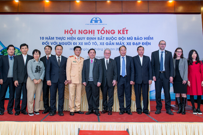Vietnam's Minister of Transport (centre with AIP Foundation founder Greig Craft) was keynote speaker at a Review conference to assess progress ten years on from the helmet legislation.