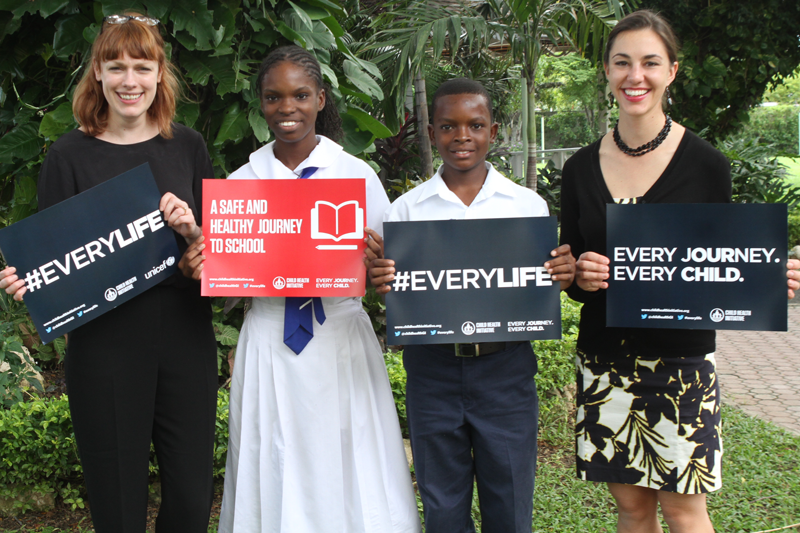 FIA Foundation's Rebecca Ashton and Natalie Draisin campaigning with Jamaican schoolchildren.