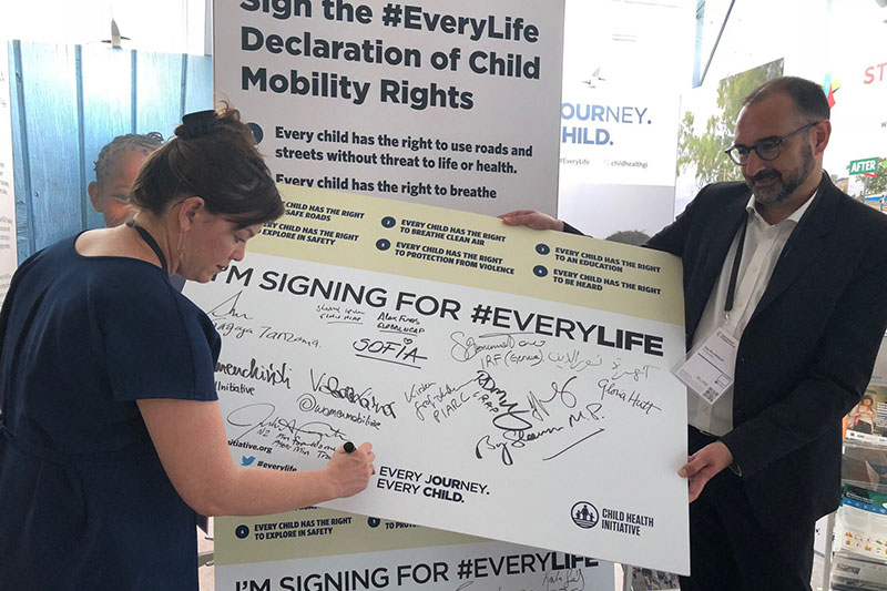 Julie Ann Genter, Minister for Women, Transport and Health in New Zealand signs the #EveryLife Declaration at ITF 2018.
