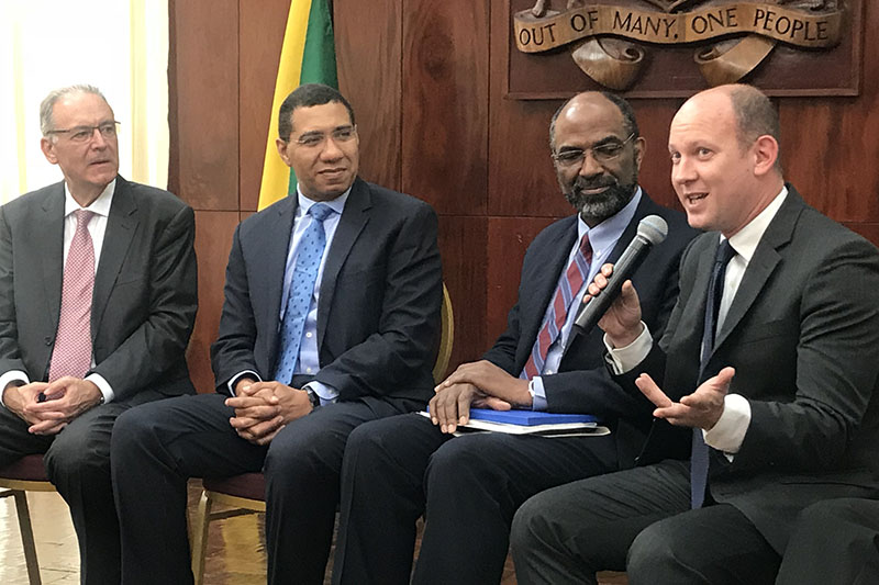 FIA Foundation Deputy Director Avi Silverman and AA Jamaica President Earl Jarrett brief Jamaican Prime Minister Andrew Holness on the progress of the street improvements following star rating for schools assessments.